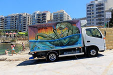 WD Street art painting a truck in mata for Malta Stree art Festival by Add Mor Colors