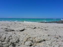 eau turquoise et sable blanc