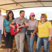 Israel singing on the boat