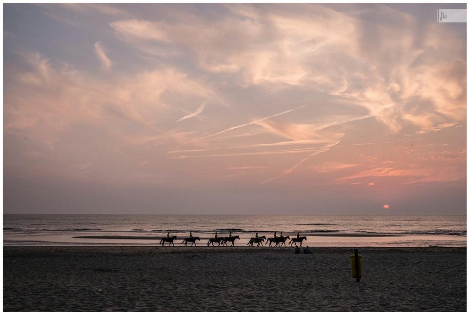 reiten am Strand Sonnenuntergang