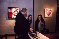 Visitors discuss prints