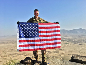 Brent with the US Flag on top of a mount