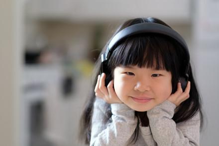 a-young-asian-girl-enjoying-listening-to