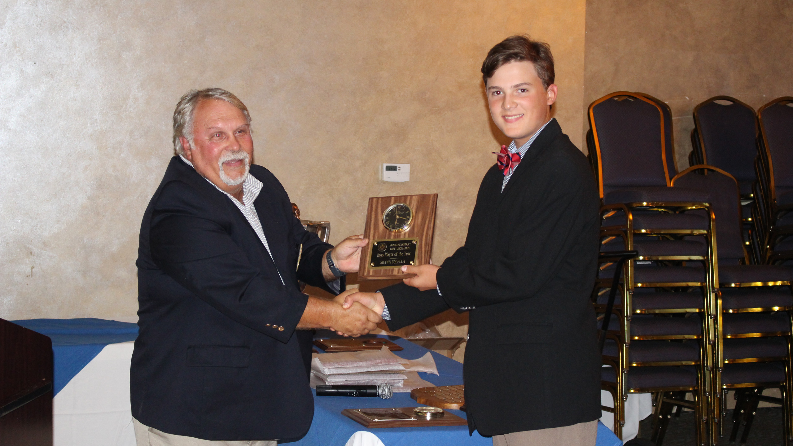 Boys Player of the Year Shawn Colella with Gene Meyle, SDGA Junior Chairman.
