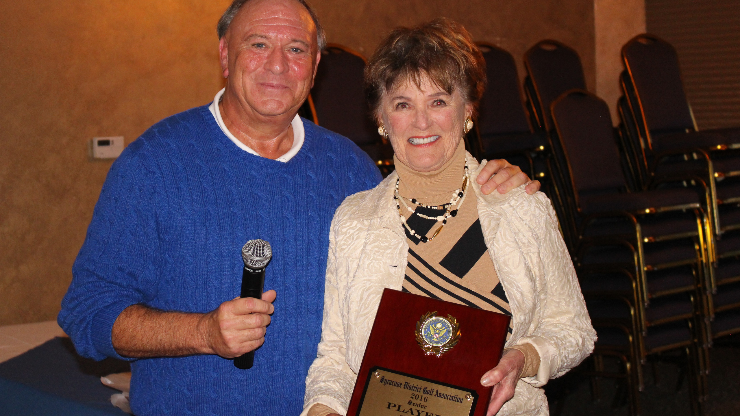 Accepting the award for Mike Naton, 2016 Senior Player of the Year, was his mother Joan.