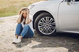 worried-young-woman-sitting-near-broken-