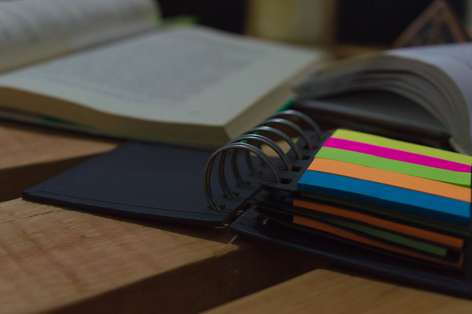 Color annotator and old book on wooden p