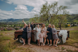 The bridal party laughing at The Manor House during a southern Colorado foothills wedding.