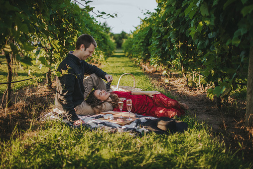 Man and women relax in the vineyard at Villa Bellezza.