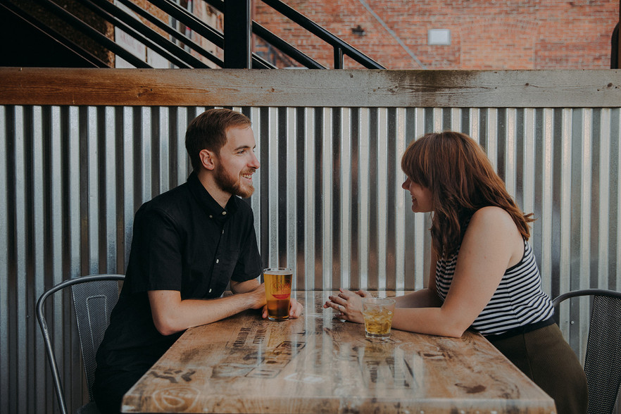 A man and women laugh together at Guu's on Main in Downtown Stevens Point
