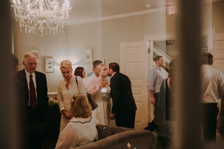 A bride, groom and wedding guests enjoy their  reception