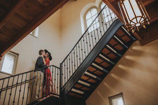 Man and women in the staircase of the Villa Bellezza.