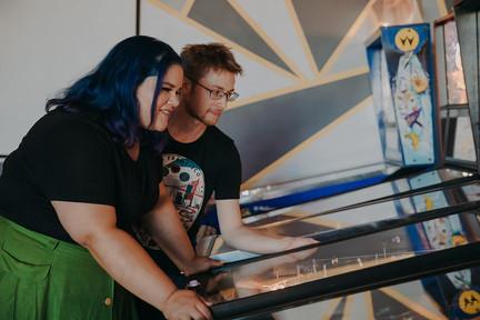 A man and women play pinball at I/O Arcade Bar in Madison Wisconsin