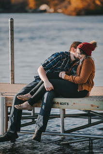 Man and a women laugh together on a dock in Pfiffner Park