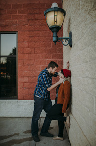 Man and a women look into each others eyes during Stevens Point Engagment session