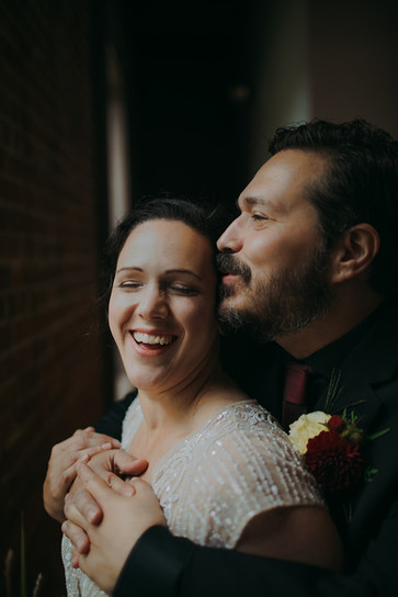 Bride and groom pose in the Pfiffner building
