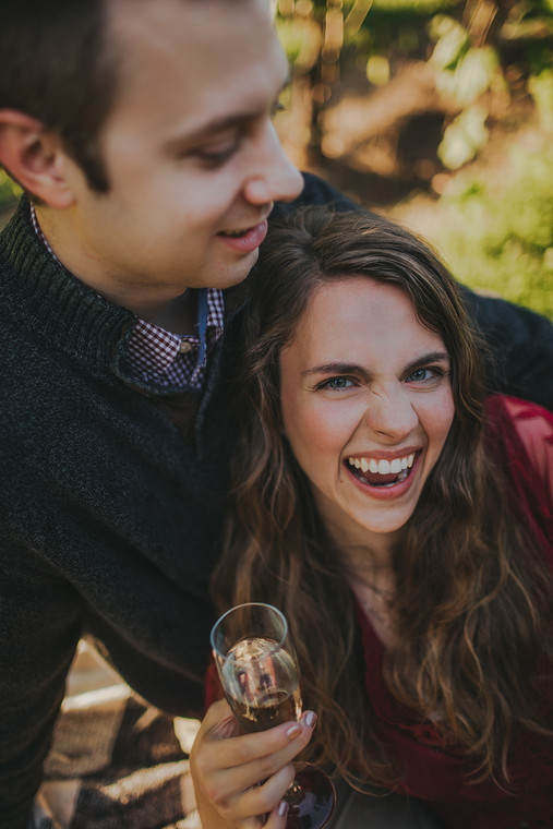 Woman laughs with man at the Villa Bellezza.