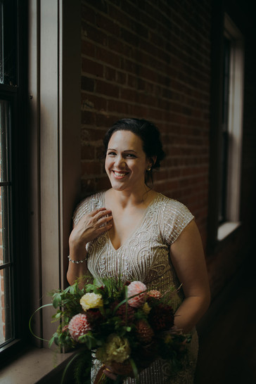 Bride poses at her industrial wedding in the Pfiffner building