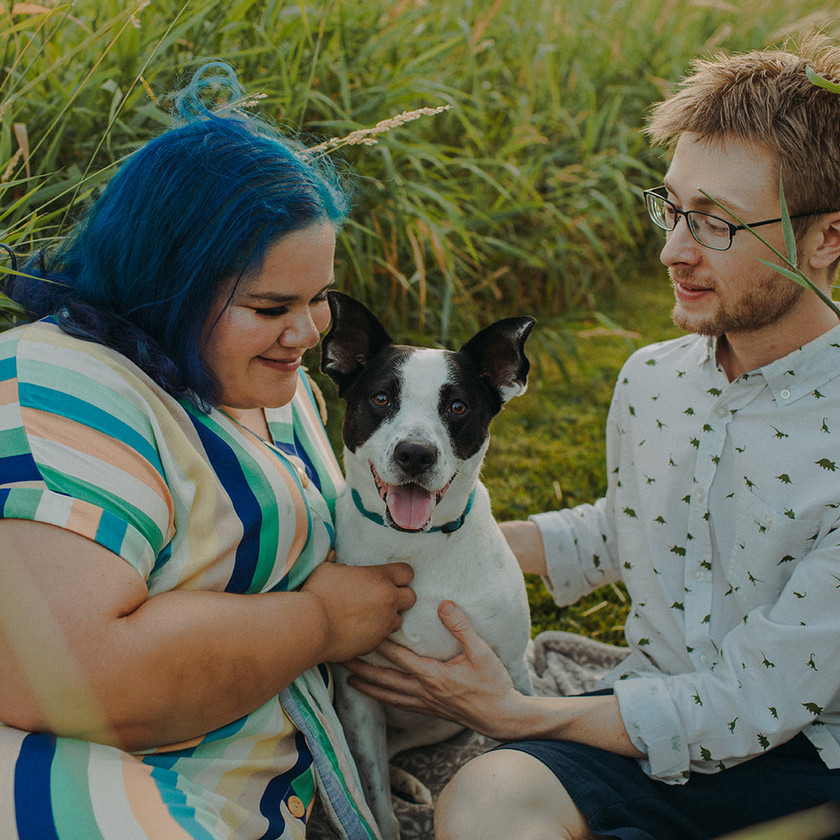 A couple and their black and white dog in My dog and me park