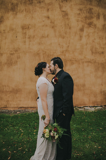 Bride and groom kiss in Stevens Point, WI industrial wedding