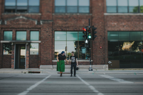 A man and woman hold hands crossing the street in Madison Wisconsin