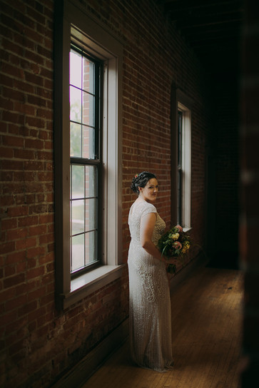 Bride poses in the Pfiffner building