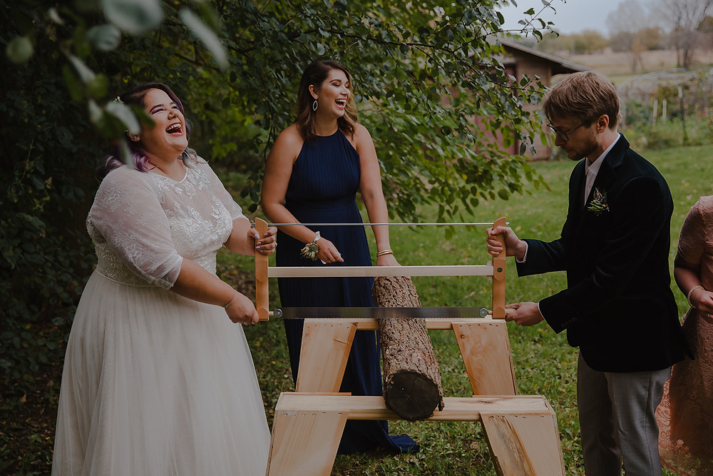 Bride and Groom saw a log in a German wedding tradition at Emily's Ten Oaks Ranch