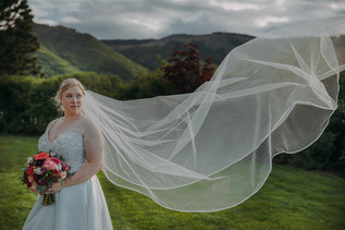 A brides veil flows in the wind