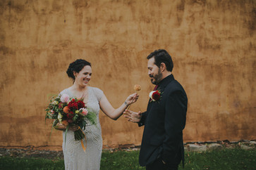 Bride gives groom a flower  in Stevens Point, WI industrial wedding
