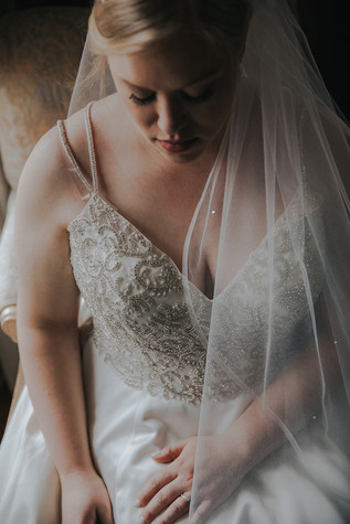 A close up of a brides beaded gown