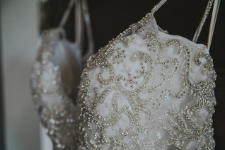 A beautiful beaded wedding dress The Manor House during a southern Colorado foothills wedding.