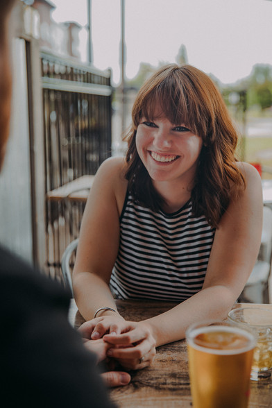 A women laughs at Guu's on Main in Downtown Stevens Point