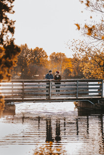 Man and a women look at each other on a bridge in Pfiffner Park