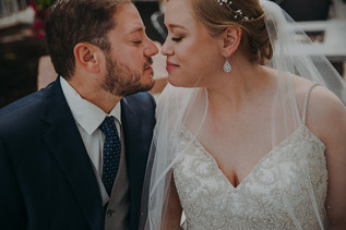 a bride and groom barely touch noses