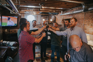 Groomsman share a toast at The Manor House during a southern Colorado foothills wedding.