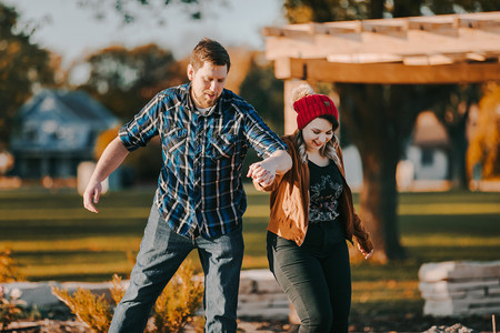 Man and women bumps hips together in Pfiffner Park