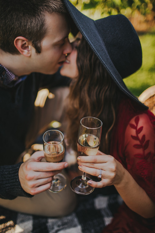 Couple gives a toast at the Villa Bellezza vineyard