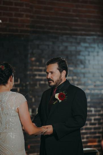 Groom during wedding ceremony in Pfiffner building