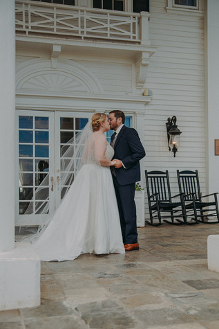 A bride and groom share a kiss