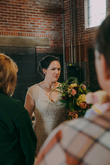 View of the bride from behind guests in Stevens Point industrial wedding