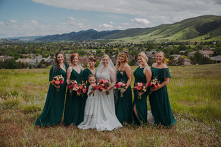 A bride and bridesmaids smile together
