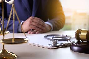 Canva - Law gavel stethoscope Health car