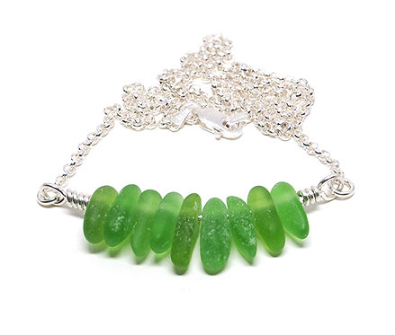 Green sharks tooth style necklace