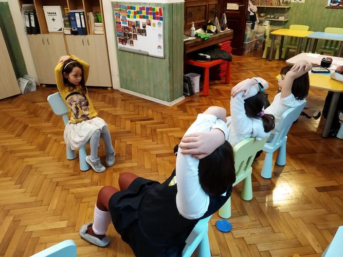 Kids doing the breathing exercises