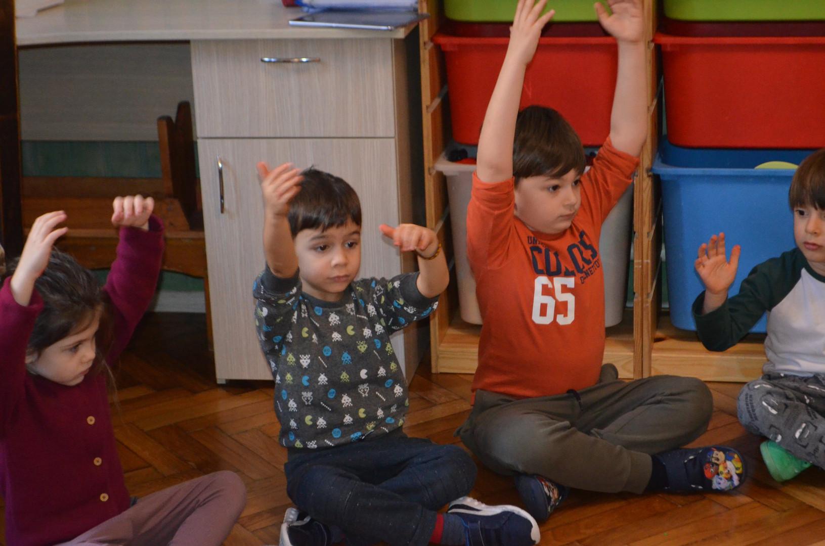 Children relaxing through breathing exercises