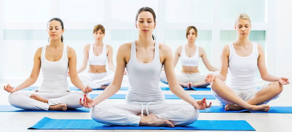 This image is about women practicing yoga in padmasana at Yogalize