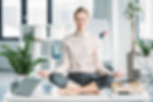 Canva - happy businesswoman meditating i