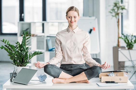 Canva - happy businesswoman meditating i