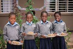 Four children that are recipients of donations in Africa