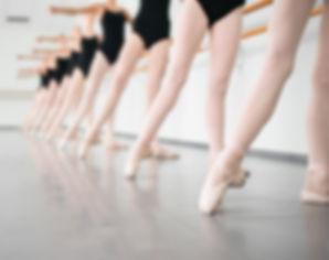 legs of young dancers ballerinas in clas